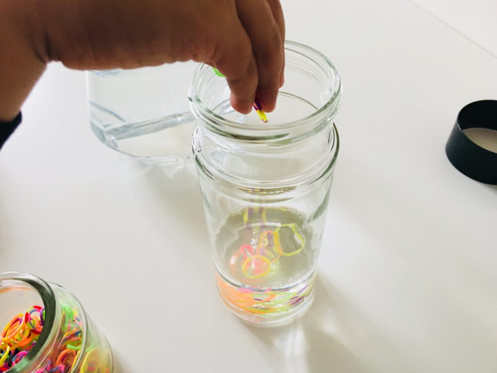 adding some loom bands to our my toddler putting some oil into the a close up of the items you can put in Sensory calm down bottles