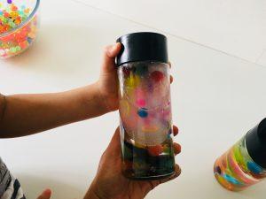 shaking our sensory calm down bottles